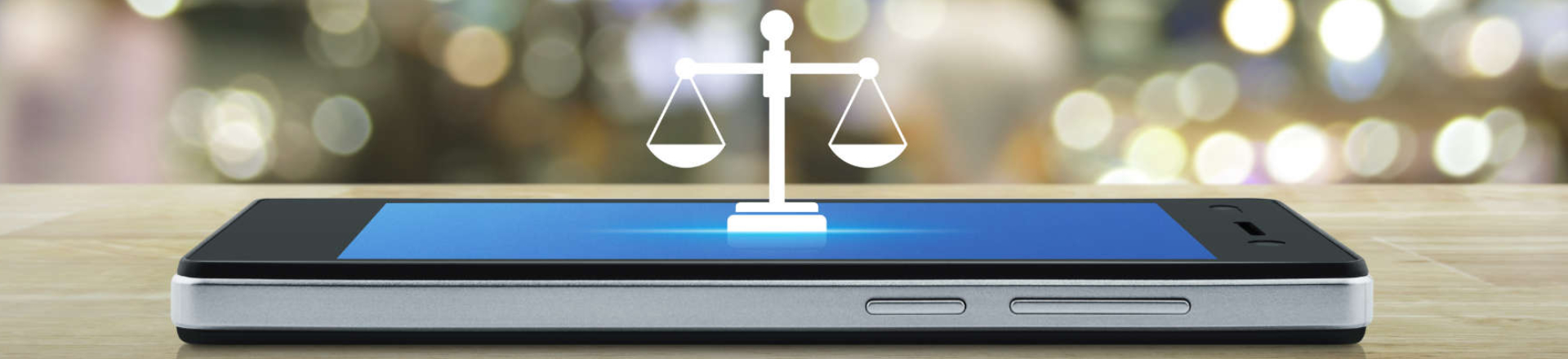 a symbol of justice scales on a smartphone