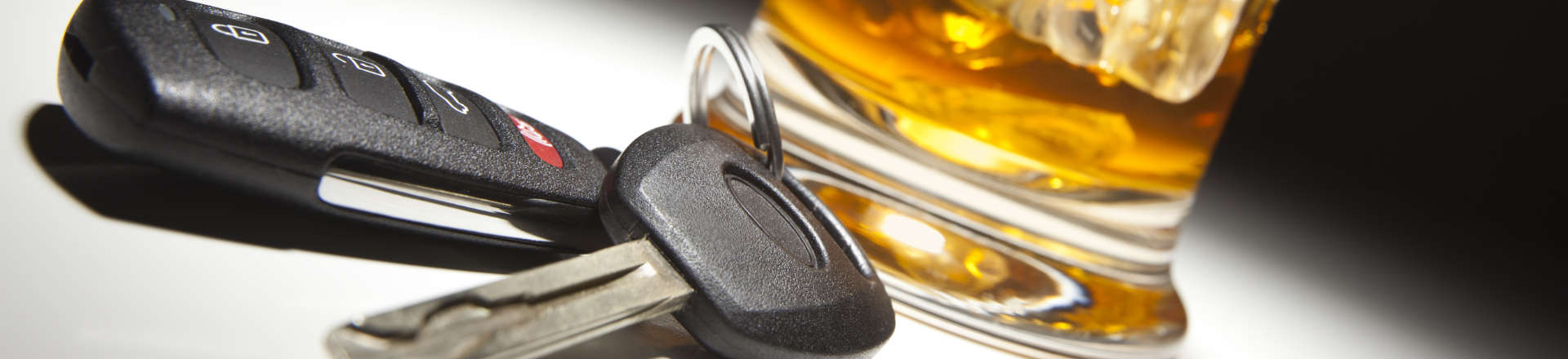 car keys next to a glass with drink