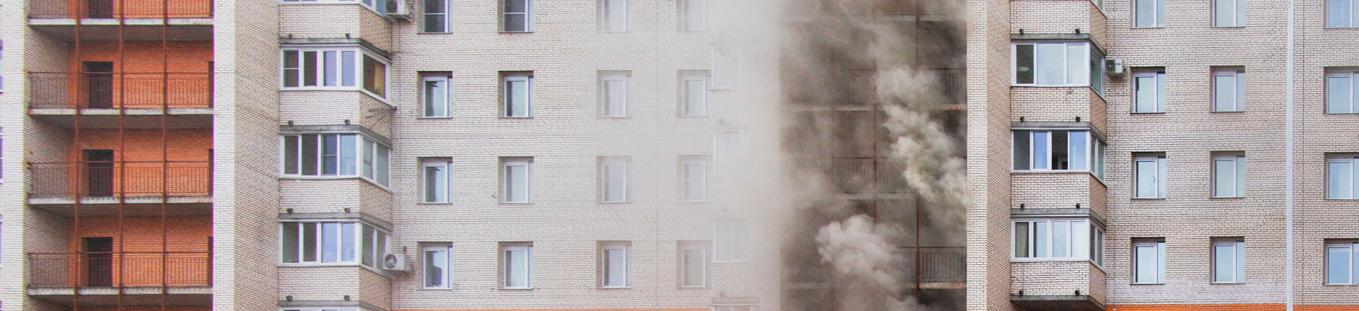 smoke coming out of an apartment building