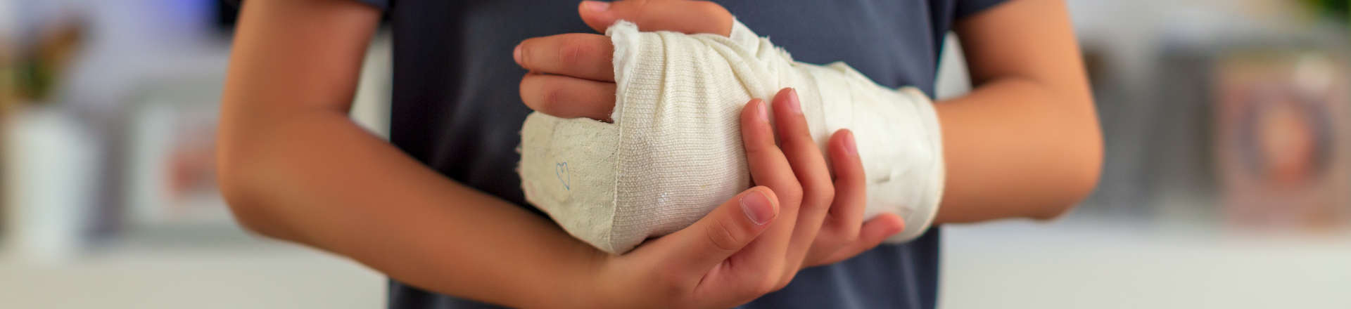 a child with injured hand covered with a bandage