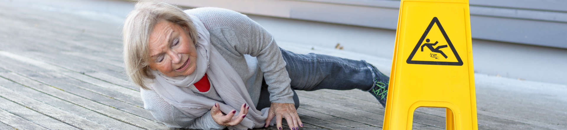 a woman on the wooden deck after slip and fall