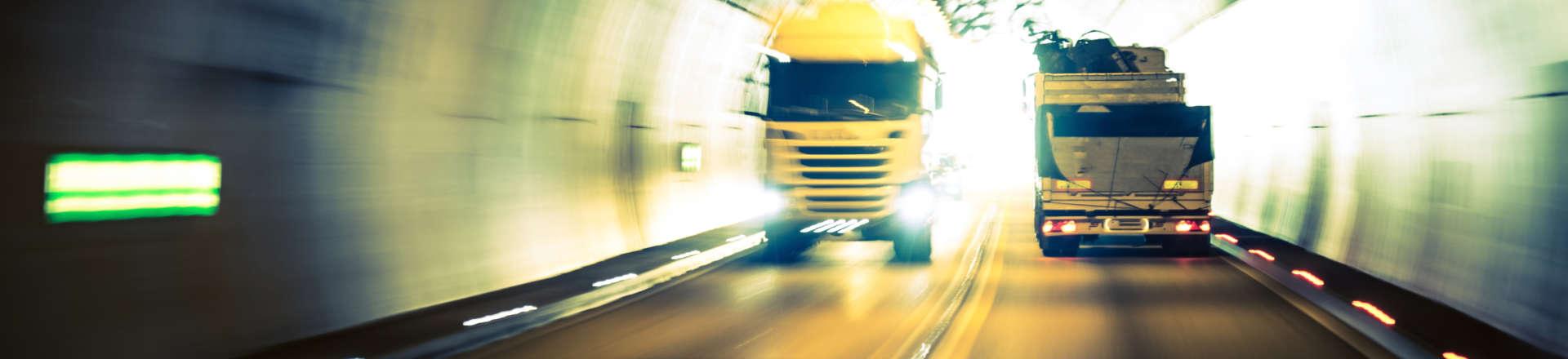 a speeding truck going through a tunnel